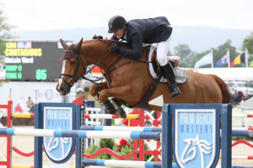 McLain Ward Jumping Contagious over a fence